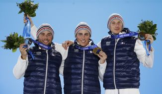 Men's skicross medalists, from left, Arnaud Bovolenta, silver, Jean Frederic Chapuis, gold, and Jonathan Midol, bronze, all from France, pose with their medals at the 2014 Winter Olympics in Sochi, Russia, Thursday, Feb. 20, 2014. (AP Photo/David Goldman)