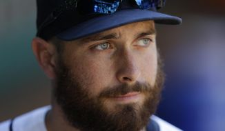 This Aug. 11, 2013 photo shows Seattle Mariners' Dustin Ackley in the dugout during a post-game interview in Seattle. The Mariners are hoping Ackley is back to the hitter he was coming out of college and early in his Seattle career, and less like the uncertain, often fiddling hitter he was during the 2012 and early part of the 2013 season. (AP Photo/Ted S. Warren)