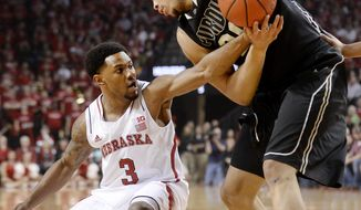 Nebraska guard Benny Parker (3) reaches in to strip the ball from Purdue center A. J. Hammons, right, during the first half of an NCAA college basketball game in Lincoln, Neb., on Sunday, Feb. 23, 2014. (AP Photo/Francis Gardler)