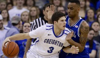 Creighton's Doug McDermott (3) drives around Seton Hall's Brandon Mobley (2) in the first half of an NCAA college basketball game in Omaha, Neb., Sunday, Feb. 23, 2014. (AP Photo/Nati Harnik)