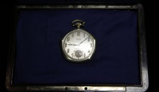 A pocket watch that was given to Babe Ruth in 1923 is displayed at Heritage Auctions office in Dallas, in this Jan. 22, 2014 file photo. The watch from the 1923 World Series sold for $717,000 Saturday Feb. 22, 2014 at auction in New York City. Ruth batted .368 and hit three home runs in the series, the first of the Yankees' 27 world championships. (AP Photo/LM Otero)