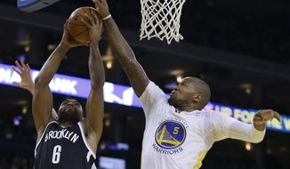 Brooklyn Nets' Alan Anderson (6) shoots against Golden State Warriors' Marreese Speights during the first half of an NBA basketball game Saturday, Feb. 22, 2014, in Oakland, Calif. (AP Photo/Ben Margot)