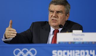 International Olympic Committee President Thomas Bach answers a question during a news conference at the 2014 Winter Olympics, Sunday, Feb. 23, 2014, in Sochi, Russia. (AP Photo/Morry Gash)