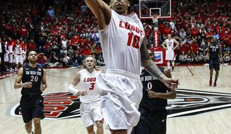 New Mexico's Kendall Williams (10) scores on a breakaway during the first half of an NCAA college basketball game against San Diego State at The Pit in Albuquerque, N.M., Saturday, Feb. 22, 2014. (AP Photo/Juan Antonio Labreche)