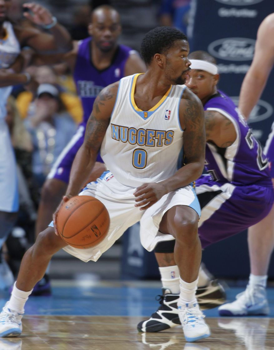 Denver Nuggets guard Aaron Brooks (0) picks up a loose ball as Sacramento Kings guard Isaiah Thomas covers in the first quarter of an NBA basketball game in Denver on Sunday, Feb. 23, 2014. (AP Photo/David Zalubowski)