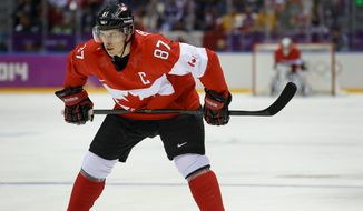 Canada forward Sidney Crosby waits for a face-off against Sweden during the first period of the men's gold medal ice hockey game at the 2014 Winter Olympics, Sunday, Feb. 23, 2014, in Sochi, Russia. (AP Photo/Matt Slocum)