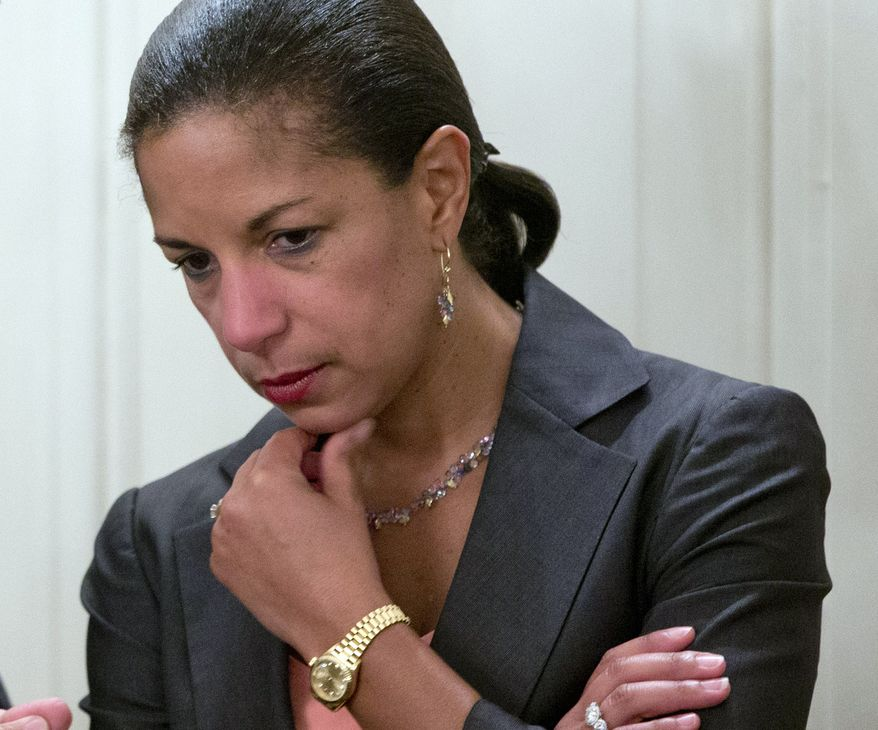 "FILE - In this July 25, 2013, file photo U.S. National Security Adviser Susan Rice is seen at the White House in Washington. Sunday, Feb. 23, 2014, Rice said on NBC's ""Meet the Press"" that it would be a ""grave mistake"" for Russia to intervene militarily in Ukraine. Rice said during that during President Barack Obama's phone conversation Friday with Russian President Vladimir Putin, the two leaders agreed that a political settlement in Kiev should ensure the unity of the country and the right of Ukrainians to express their free will. (AP Photo/Carolyn Kaster)"