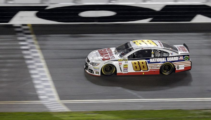 Dale Earnhardt Jr. (88) races to the finish line to win the NASCAR Daytona 500 Sprint Cup series auto race at Daytona International Speedway in Daytona Beach, Fla., Sunday, Feb. 23, 2014. (AP Photo/Chuck Burton)