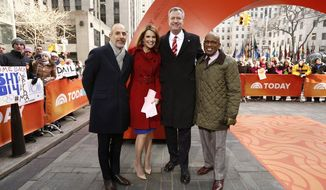 "This Monday, Feb. 24, 2014 photo released by NBC shows, from left, Matt Lauer, Savannah Guthrie, Mayor Bill De Blasio, and Al Roker on NBC's ""Today"" show in New York. De Blasio appeared on ""Today"" to help cut the ribbon on the show's new outdoor plaza.  (AP Photo/NBC, Peter Kramer)"