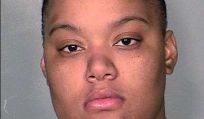 FILE - This Dec. 30, 2013 file booking photo provided by Las Vegas Metropolitan Police Department, shows Brittanie Merritt-Burwell of Glendale, Ariz., at the Clark County Detention Center, in Las Vegas. Merritt-Burwell, 22,  pleaded guilty Monday, Feb. 24, 2014, to attempted murder in the Dec. 23 shooting that badly wounded a 29-year-old man. Her 28-year-old co-defendant, Joshua Youngblood, faces  faces trial on a concealed weapon charge. Prosecutor Megan Thompson says the wounded motorist is recovering from his injuries. (AP Photo/Clark County Detention Center, File)