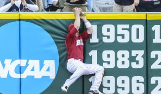 Alabama's Ben Moore makes a leaping play to save a home run and end the game during an NCAA college baseball game against Stephen F. Austin, Saturday, Feb. 22, 2014, in Tuscaloosa, Ala. (AP Photo/AL.com, Vasha Hunt)