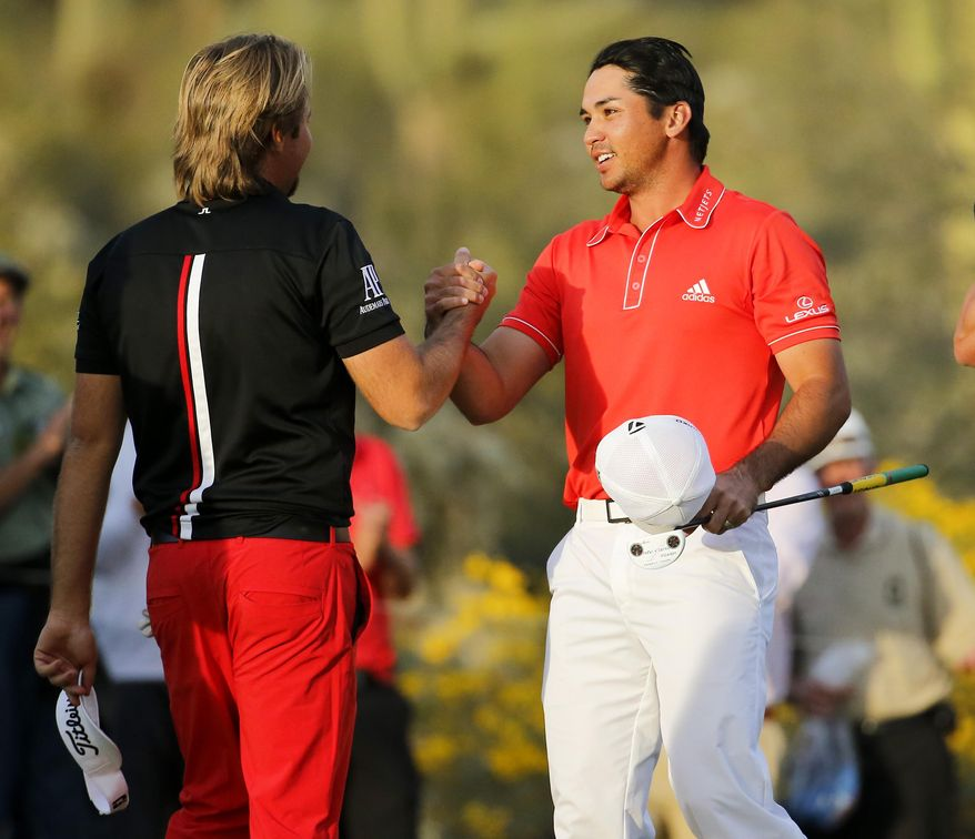 Jason Day, of  Australia, right, shakes hands on the 23rd hole after winning his championship match against Victor Dubuisson, of France, during the Match Play Championship golf tournament, Sunday, Feb. 23, 2014, in Marana, Ariz. (AP Photo/Matt York)