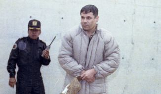 "** FILE ** In this June 10, 1993, file photo, Mexican drug lord Joaquin ""El Chapo"" Guzman is shown to the press at the Almoloya de Juarez, a high security prison on the outskirts of Mexico City. (AP Photo/Damian Dovarganes, File)"