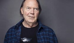 FILE - This Sept. 27, 2012 file photo shows singer-songwriter Neil Young posing for a portrait at The Carlyle hotel in New York. The Rock and Roll Hall of Famer has a deal with Blue Rider Press for a book focusing on his passion for cars, while also featuring stories about his life in music. Blue Rider, an imprint of Penguin Random House, told The Associated Press on Monday, Feb. 24, 2014, that the new book is scheduled for fall 2014 and is currently untitled.  (Photo by Victoria Will/Invision/AP, file)
