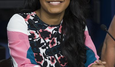 "Actress Keke Palmer smiles during a roundtable discussion after a screening of the movie ""The Trip to Bountiful"" in the South Court Auditorium on the White House complex on Monday, Feb. 24, 2014, in Washington. (AP Photo/ Evan Vucci)"