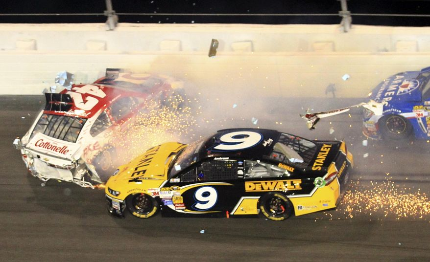 Kyle Larson (42) and Marcos Ambrose (9) crash during the NASCAR Daytona 500 Sprint Cup series auto race at Daytona International Speedway in Daytona Beach, Fla., Sunday, Feb. 23, 2014. (AP Photo/John Chilton)