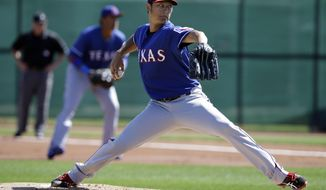 Texas Rangers pitcher Yu Darvish (11) of Japan delivers to the plate in an intrasquad game during spring training baseball practice, Monday, Feb. 24, 2014, in Surprise, Ariz. (AP Photo/Tony Gutierrez)