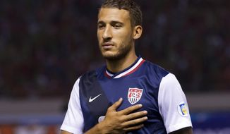 FILE - In this Sept. 6, 2013, file photo, United States' Fabian Johnson stands prior to a 2014 World Cup qualifying soccer match against Costa Rica in San Jose, Costa Rica. Borussia Moenchengladbach has signed U. S. midfielder Fabian Johnson from Bundesliga rival Hoffenheim as of next season. (AP Photo/Moises Castillo, File)