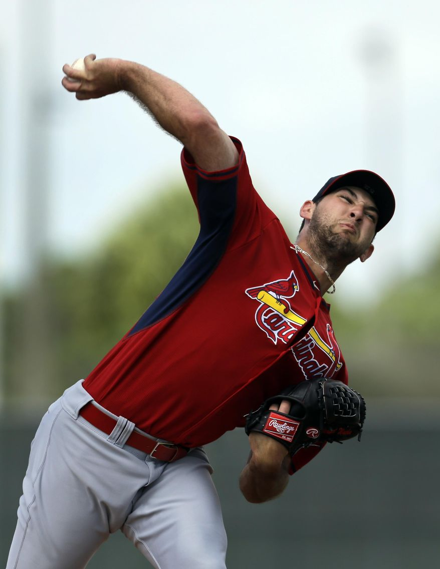 St. Louis Cardinals pitcher Michael Wacha throws live batting practice during spring training baseball Friday, Feb. 21, 2014, in Jupiter, Fla. (AP Photo/Jeff Roberson)
