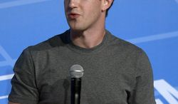 Mark Zuckerberg Chairman and CEO of Facebook speaks during a conference at the Mobile World Congress, the world's largest mobile phone trade show in Barcelona, Spain, Monday, Feb. 24, 2014. Expected highlights include major product launches from Samsung and other phone makers, along with a keynote address by Facebook founder and chief executive Mark Zuckerberg. (AP Photo/Manu Fernandez)