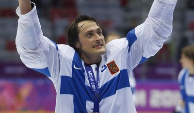 Finland forward Teemu Selanne points to fans after Finland beat the USA 5-0 in the men's bronze medal ice hockey game at the 2014 Winter Olympics, Saturday, Feb. 22, 2014, in Sochi, Russia. (AP Photo/Petr David Josek)