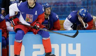Czech Republic forward Jaromir Jagr sits on the boards waiting to enter the game during the third period of men's quarterfinal hockey game against the United States in Shayba Arena at the 2014 Winter Olympics, Wednesday, Feb. 19, 2014, in Sochi, Russia. (AP Photo/David J. Phillip )
