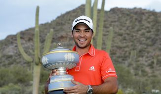 Jason Day, of Australia, poses with the trophy after winning his championship match against Victor Dubuisson, of France, during the Match Play Championship golf tournament on Sunday, Feb. 23, 2014, in Marana, Ariz. (AP Photo/Ted S. Warren)