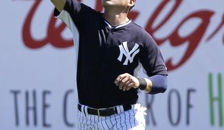 New York Yankees center fielder Jacoby Ellsbury catches a fly ball during spring training baseball practice Thursday, Feb. 20, 2014, in Tampa, Fla. (AP Photo/Charlie Neibergall)