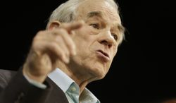 Former Congressman Ron Paul gestures during a rally for Republican gubernatorial candidate Ken Cuccinelli in Richmond, Va., Monday, Nov. 4, 2013.   Cuccinelli faces Democrat Terry McAuliffe in Tuesday's election. (AP Photo/Steve Helber)