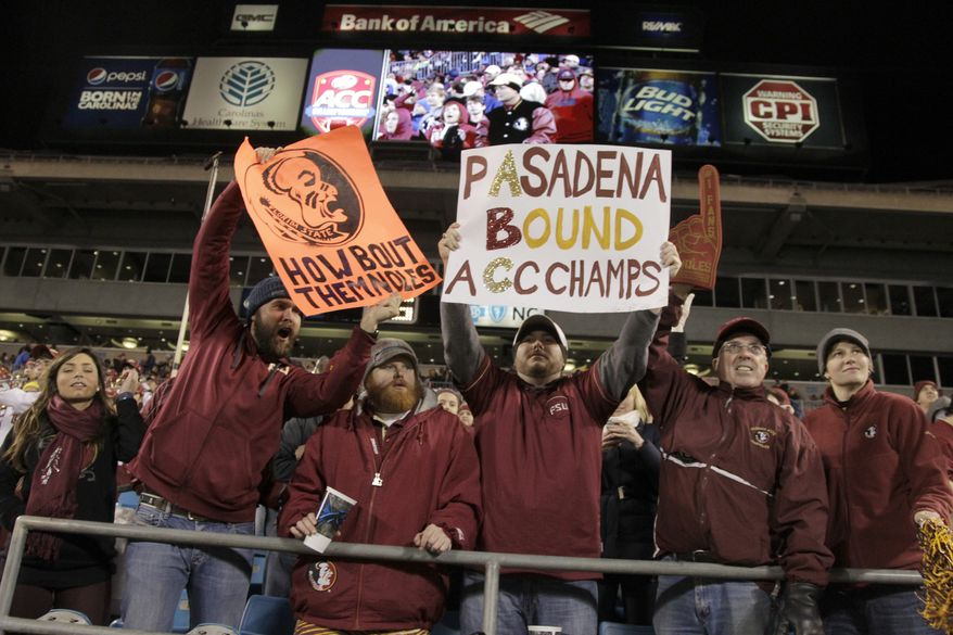 Florida State fans celebrate in the second half of the Atlantic Coast Conference Championship NCAA football game against Duke in Charlotte, N.C., Saturday, Dec. 7, 2013. (AP Photo/Bob Leverone)