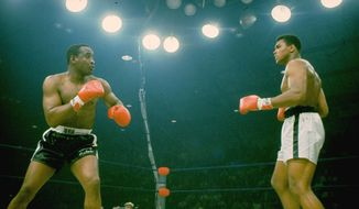 """Sonny Liston, in black trunks, is seen just before Muhammad Ali's """"phantom punch"""" that knocked him out in 1 minute, 42 seconds of the first round during their heavyweight championship bout in Lewiston, Maine on May 25, 1965.  (AP Photo/stf)"""