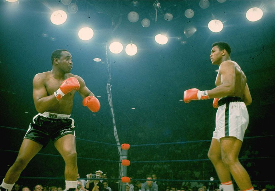 "Sonny Liston, in black trunks, is seen just before Muhammad Ali's ""phantom punch"" that knocked him out in 1 minute, 42 seconds of the first round during their heavyweight championship bout in Lewiston, Maine on May 25, 1965.  (AP Photo/stf)"
