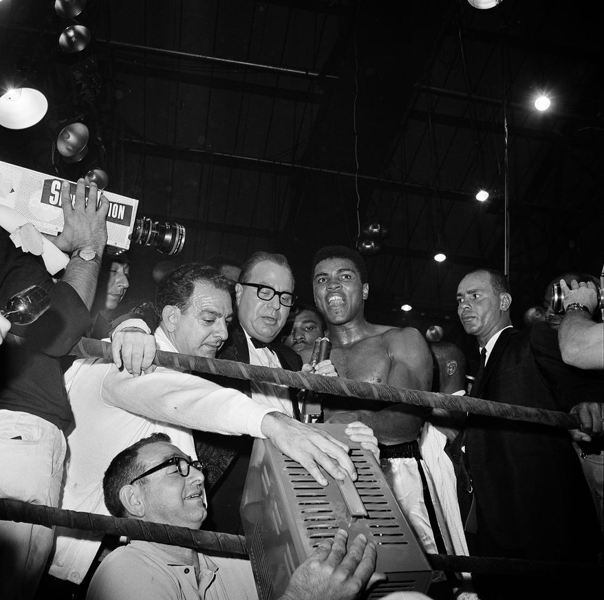Heavyweight champion Cassius Clay is seen after having successfully defended his crown with a one-minute knockout of challenger Sonny Liston, May 25, 1965 in Lewiston, Me.  It was his first defense of his title.  (AP Photo)