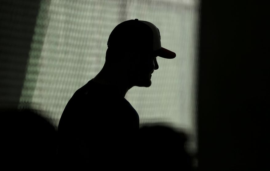 Minnesota Twins pitcher Mike Pelfrey speaks with reporters during spring training baseball practice Friday, Feb. 21, 2014, in Fort Myers, Fla. (AP Photo/Steven Senne)