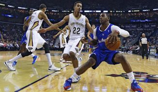 Los Angeles Clippers guard Chris Paul (3) tries to get around New Orleans Pelicans guard Brian Roberts (22) in the first half of an NBA basketball in New Orleans, Monday, Feb. 24, 2014.  (AP Photo/Bill Haber)
