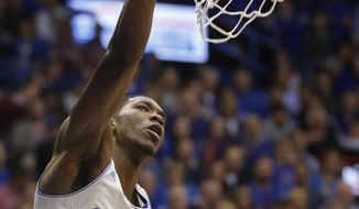Kansas center Joel Embiid dunks during the first half of an NCAA college basketball game against Oklahoma in Lawrence, Kan., Monday, Feb. 24, 2014. (AP Photo/Orlin Wagner)