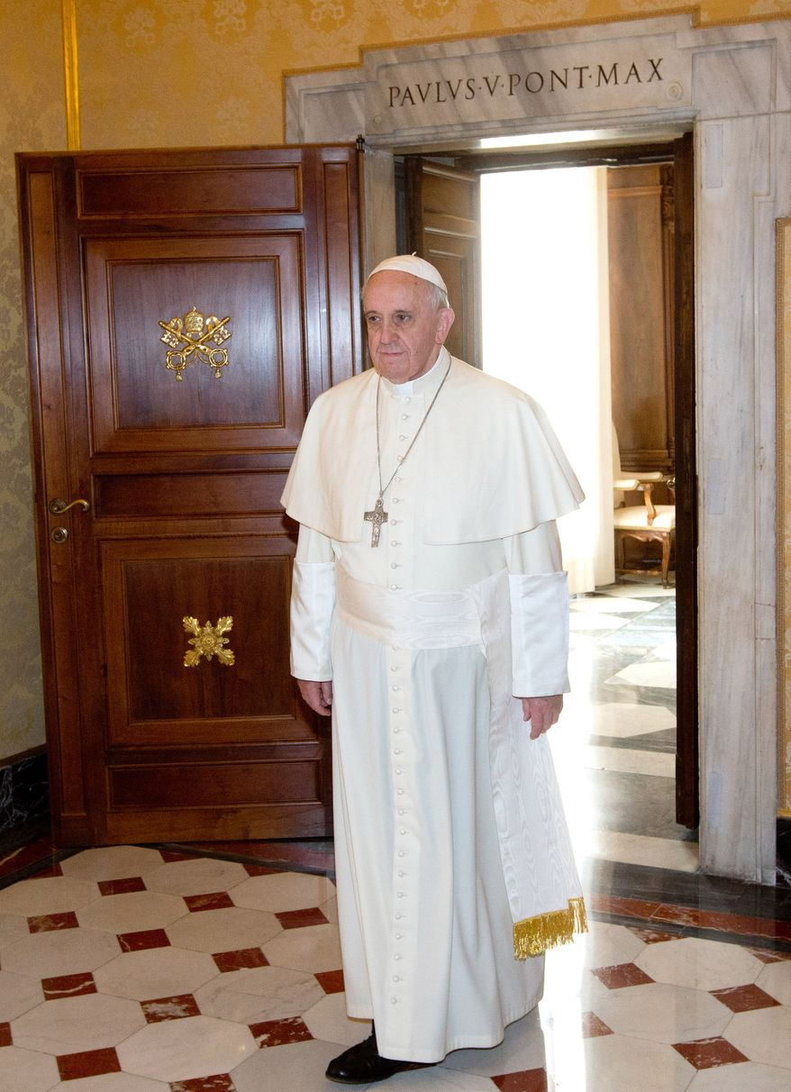 **FILE** Pope Francis arrives to meet Haitian President Michel Joseph Martelly during a private audience at the Vatican on Feb. 24, 2014. (Associated Press)