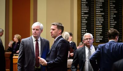 House Speaker Paul Thissen, left, and Minority Leader Kurt Daudt talked just before the start of the 2014 legislative session Tuesday, Feb, 25, 2014, in St. Paul, Minn. (AP Photo/The Star Tribune, Glen Stubbe)  MANDATORY CREDIT; ST. PAUL PIONEER PRESS OUT; MAGS OUT; TWIN CITIES TV OUT