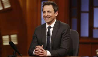 "This Feb. 24, 2014 image released by NBC shows host Seth Meyers during the premiere of his new late night talk show, ""Late Night with Seth Meyers"" in New York. (AP Photo/NBC, Peter Kramer)"