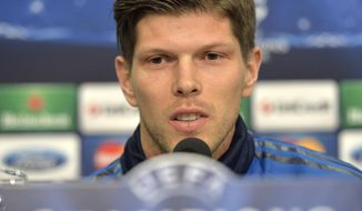 Schalke's forward Klaas-Jan Huntelaar of the Netherlands talks to the media during a press conference prior to the UEFA Champions League first leg knock out soccer match between FC Schalke 04 and Real Madrid in Gelsenkirchen, Tuesday, Feb. 25, 2014. (AP Photo/Martin Meissner)