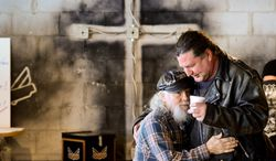 Salvation: Fred Bennett (left) says he has found God and a way to forgive Daryl Artist (right), who years ago stabbed Mr. Bennett's son seven times over a dispute. Both attend Freedom Biker Church in Chesapeake, Va. (Andrew Harnik/The Washington Times)