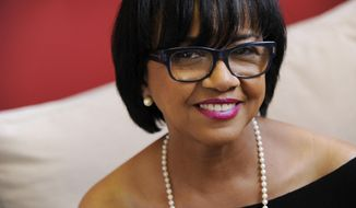 In this Wednesday, Feb. 19, 2014 photo, Cheryl Boone Isaacs, president of the Academy of Motion Picture Arts and Sciences, poses for a portrait in Los Angeles. Isaacs has become the third female Academy of Motion Picture Arts and Sciences president and the first ever African-American head of the organization. (Photo by Chris Pizzello/Invision/AP)