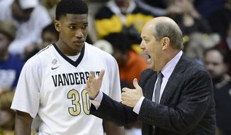 Vanderbilt head coach Kevin Stallings talks to Vanderbilt forward Damian Jones (30) during a timeout in the second half of an NCAA college basketball game against Florida on Tuesday, Feb. 25, 2014, in Nashville, Tenn. Florida won 57-54. (AP Photo/Mark Zaleski)