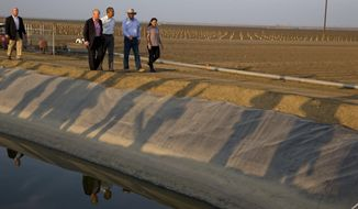 File - In this Feb. 14, 2014, file photo, President Barack Obama tours a local farm that has been affected by drought with Calif. Gov. Jerry Brown, left, Joe Del Bosque, Empresas Del Bosque, Inc., right, and Maria Gloria Del Bosque, Empresas Del Bosque, Inc., in Los Banos, Calif. NASA scientists have begun deploying satellites and other advanced technology to help California water officials assess the state's record drought and better manage it, officials said Tuesday. (AP Photo/Jacquelyn Martin, File)