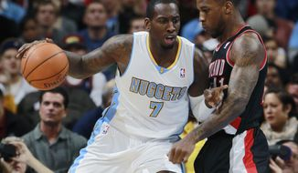 Denver Nuggets forward J.J. Hickson, left, works ball inside or shot as Portland Trail Blazers forward Thomas Robinson covers in the first quarter of an NBA basketball game in Denver, Tuesday, Feb. 25, 2014. (AP Photo/David Zalubowski)