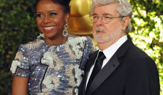 FILE - In this Nov. 16, 2013 file photo, filmmaker George Lucas and his wife Mellody Hobson are seen on the red carpet at the 2013 Governors Awards in Los Angeles. The University of Chicago said Tuesday, Feb. 25, 2014, that Lucas and Hobson are donating $25 million to the prestigious private school. The grant from The George Lucas Family Foundation will pay for a new arts hall at the university's Laboratory Schools.(Photo by John Shearer/Invision/AP)