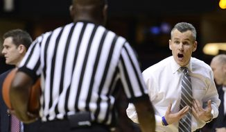 Florida head coach Billy Donovan talks with an official in the second half of an NCAA college basketball game against Vanderbilt, Tuesday, Feb. 25, 2014, in Nashville, Tenn. Florida won 57-54. (AP Photo/Mark Zaleski)