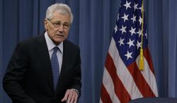 Defense Secretary Chuck Hagel arrives to brief reporters at the Pentagon, Monday, Feb. 24, 2014, where he recommended shrinking the Army to its smallest size since the buildup to U.S. involvement in World War II in an effort to balance postwar defense needs with budget realities. (AP Photo/Carolyn Kaster)