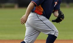 Houston Astros' Jose Altuve keeps his eye on the ball as he moves in position during a spring training baseball workout, Friday, Feb. 21, 2014, in Kissimmee, Fla. (AP Photo/Alex Brandon)