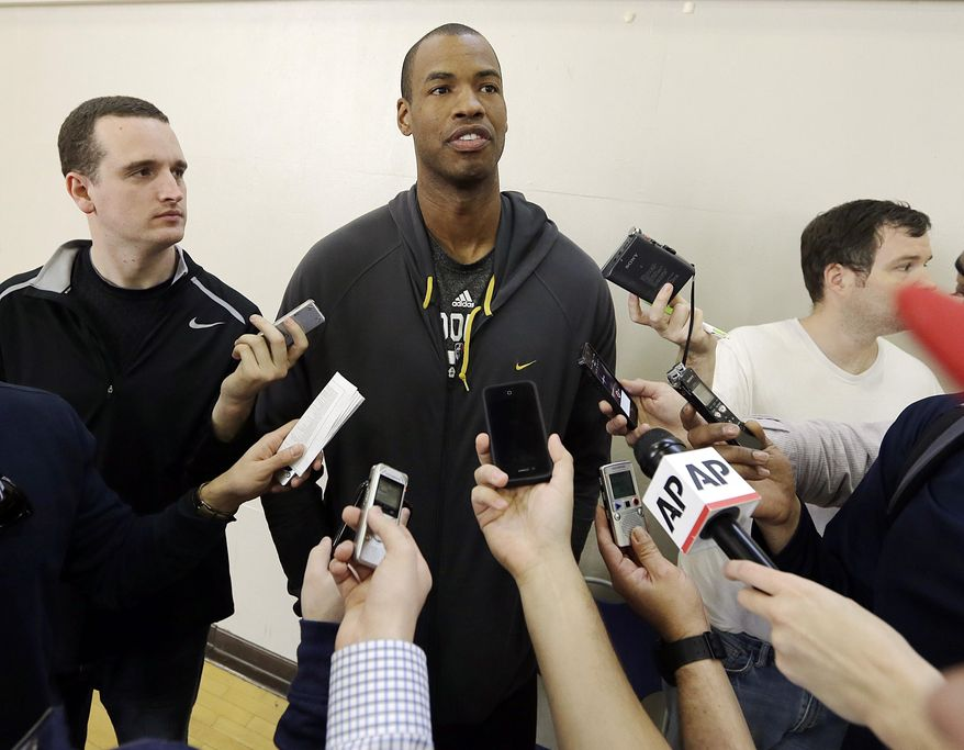 Brooklyn Nets center Jason Collins talks with reporters during  practice on the campus of UCLA in Los Angeles Tuesday, Feb. 25, 2014.  Collins became the first openly gay active athlete in North America's four major professional sports Sunday, Feb. 23, signing a 10-day contract with the Brooklyn Nets. (AP Photo/Reed Saxon)